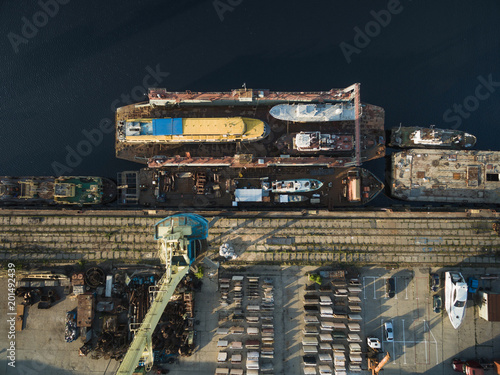 Foto Murales aerial view of various ships in industrial harbour