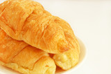 Close up freshly baked croissants on white background with copy space.
