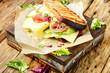 Sandwiches on cutting board - 201604482