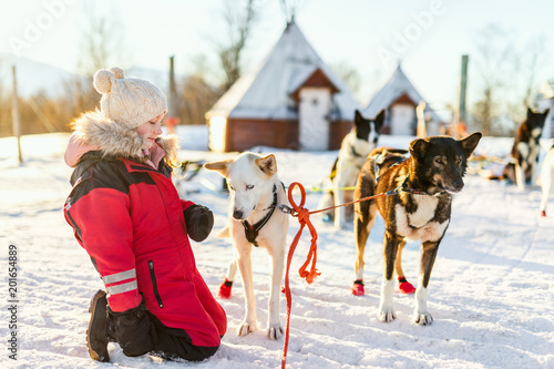 Little girl with husky dog