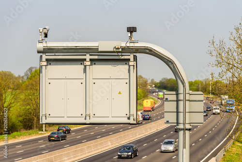 Sunny day view of UK motorway traffic with CCTV camera on foreground © Jevanto Productions