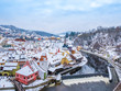 Panoramic view of Cesky Krumlov in winter season, Czech Republic. View of the snow-covered roofs. Travel and Holiday in Europe. Christmas and New Year time. Sunny winter day in european town. - 201688400