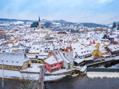 Panoramic view of Cesky Krumlov in winter season, Czech Republic. View of the snow-covered roofs. Travel and Holiday in Europe. Christmas and New Year time. Sunny winter day in european town. - 201688421