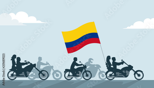 Bikers on motorcycles with colombia flag