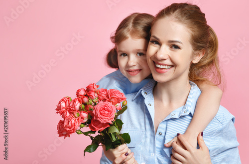 concept of mother's day. mom and child with flower on colored background - 201695657