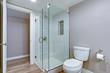 Elegant bathroom with hardwood floor.