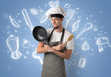 Young cook with kitchen instruments and drawn recipe concept on wallpaper - 201700259