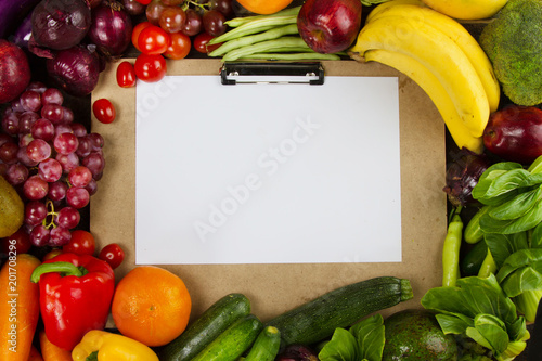 Clean fruits and vegetable with paper board put on middle frame, Diet program with clean healthy food concept.