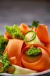 Artistically served vegetable salad with carrot, cucumber, letucce over white background, selective focus