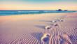 Leinwanddruck Bild - Dünen mit Fußspuren am Strand