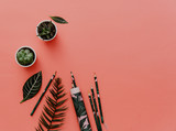 Flat lay stationery. Office supplies with tropical leaves over red background. - 201759046
