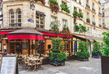 Typical view of the Parisian street with tables of brasserie (cafe) in Paris, France - 201764898