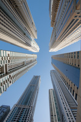 A group of skyscrapers in Dubai seen from below