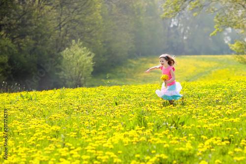 Kids play. Child in dandelion field. Summer flower - 201776239
