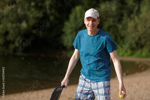 Foto Murales Man playing beach tennis