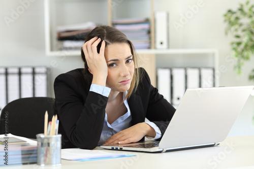 Worried office worker looking at camera © Antonioguillem