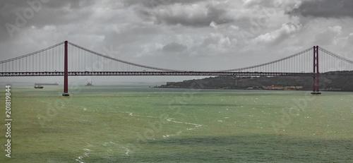 Long shot of 25 de Abril Bridge in Lisbon