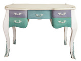 Retro white ornate wooden desk table with five colored drawers isolated on white background including clipping path