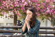 Woman sneezing because of spring pollen allergy - 201826455