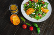 Fresh salad with tomatoes, mixed greens ,nuts, eggs, on wooden background . Healthy food. - 201833640