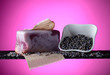 Leinwanddruck Bild - Bar of natural organic soap with lavender on violet background.