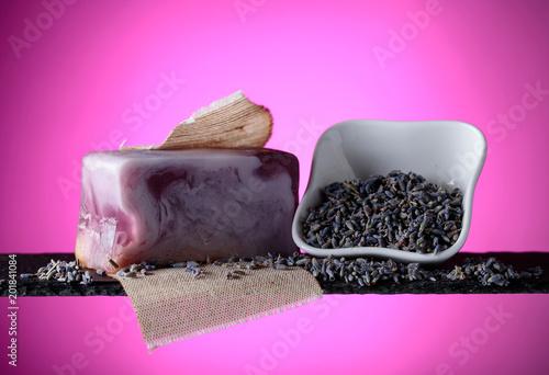 Leinwanddruck Bild Bar of natural organic soap with lavender on violet background.