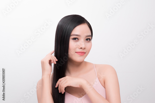 Haircare concept. Beautiful asian woman beauty girl with perfect makeup and hairstyle