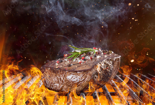 Beef steak on the grill with flames - 201855698