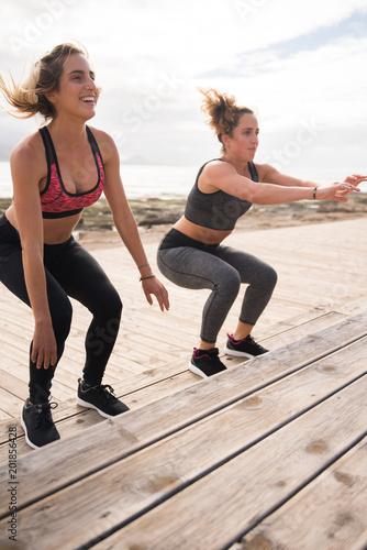 Foto Murales Pretty healthy women doing fitness exercises