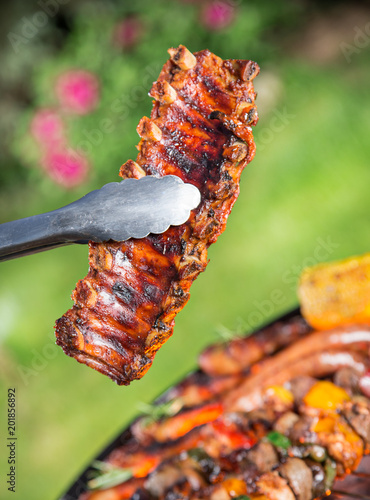Foto Murales Barbecue grill with tasty meat, close-up.