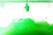 Leinwandbild Motiv Green watercolor ink drop splash diffuse on white background isolated..