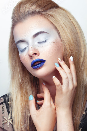 Foto Murales Creative fashion beauty portrait in blue tones on a light background.