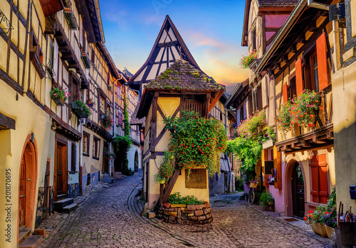 Fototapeta Colorful half-timbered houses in Eguisheim, Alsace, France