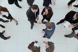 Handshake between competitors before the start of business negot - 201872440