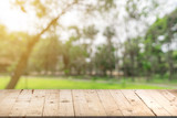 Empty wood table and defocused bokeh and blur background of garden trees in sunlight, display montage for product. - 201878477