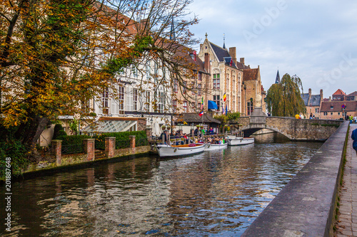 Foto Murales Brugge medieval historic city. Brugge streets and historic center, canals and buildings. Brugge popular touristic destination of Belgium.