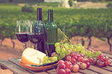 Red wine, cheese and grapes against vineyard - 201917878