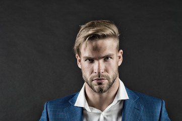 Bearded man with beard on unshaven face. Businessman with stylish haircut. Grooming and hair care in barbershop. Business fashion style and trend, vintage