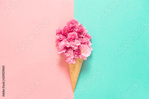 Foto Murales Cherry tree blossom in ice cream waffle cone Pink flowers
