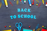 Back to school text with colorful stationary over the blackboard background - 201942811