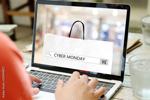 Hands typing laptop computer with cyber monday sale on search bar banner background, Online shopping, business and technology