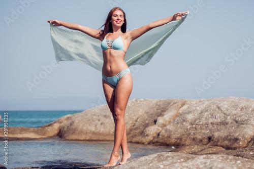 Foto Murales Woman enjoying sunny day on tropical beach