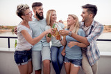Group of young friends having fun at rooftop party - 201950680