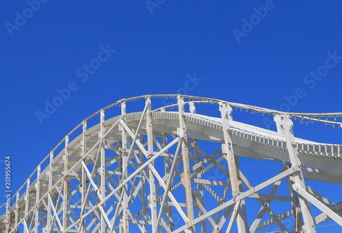 Fotobehang Amusementspark Amusement park roller coaster ride