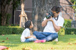 Father take photo with camera of daughter in house garden,family picnic activity.