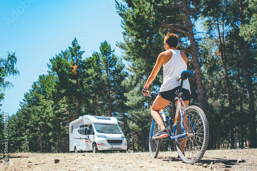 Motor home and girl with bicycle