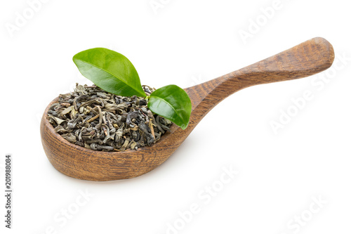 Green tea leaf the spoon isolated on white background.
