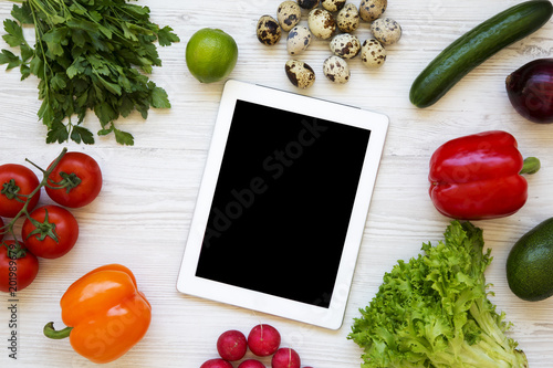 Healthy food concept. Raw food wirh tablet on a white wooden background. Flat lay. Top view. From above. - 201989679