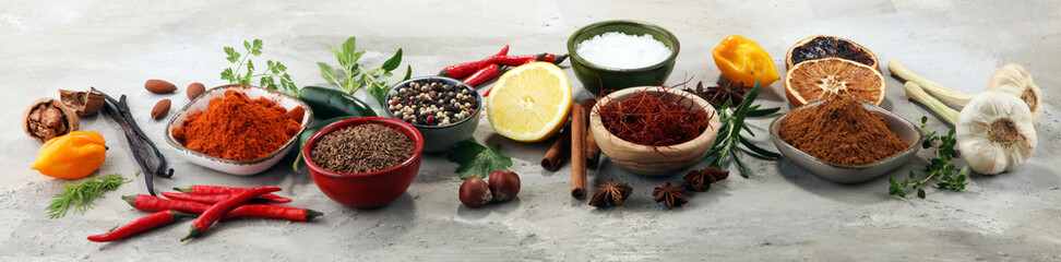 Spices and herbs on table. Food and cuisine ingredients. © beats_