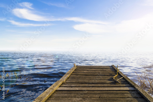 Fotobehang Pier Fantastic view of the wooden pier in the lake. Scenery background